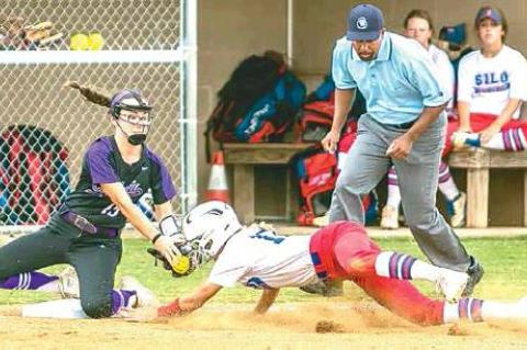—Photo by Sherry Loudermilk CLASS 2A STATE SOFTBALL TOURNAMENT (COALGATE VS SILO) - Lady Cat sophomore shortstop Kenley Thompson #15 covers third base and tags a Silo player.