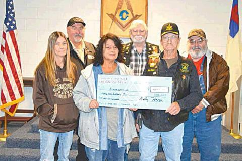 TOP PICTURE — Coalgate Masonic Lodge #211 presents a check to Diana Pebworth-Watkins to help with medical expenses for her late husband, Glenn Watkins. Glenn passed away December 2, 2019. The $4,200 check represents funds raised at a chili and beans ben