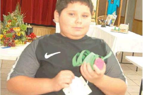 COAL COUNTY FAIR — Austin Barnett with his cute paper caterpillar that he entered in the fair. Austin is a fourth grader at Emerson Elementary.