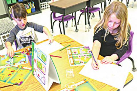 A.J. Shipman and Nash Caldwell play in their activity bug center. The purpose of the activity is to help students gain a better understanding of the similarities and differences of insects.
