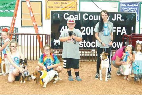 COAL COUNTY FAIR PET SHOW — Dixie Hensley with Sheba; Kristy Coats with Dixie; Kirsten Haney with Roxy; Jaxton Fortner with Dusty; Reagan Carter with Trip; Karsyn Faulkenberry with Jax; and Zailyn Lampkin with Sam (and helper Stacia Coats), from left