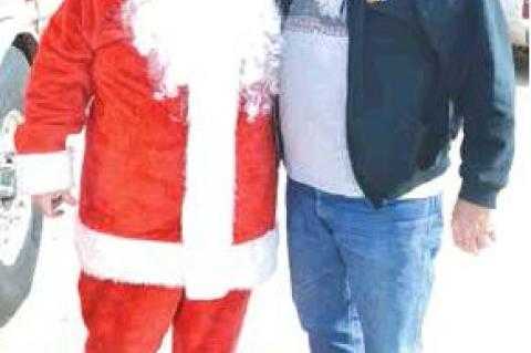 FIRE CHIEF RICK ELLIS AND SANTA