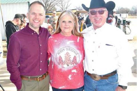 THE TUPELO KOUNTRY STORE hosted the Annual Christmas Celebration Christmas Eve. Lots of toys were given to a lot of happy youngsters. Pictured above are Rusty Pickens, Sharon PIckens (owner of the Tupelo Kountry Store) and husband, Robert. Rusty came from