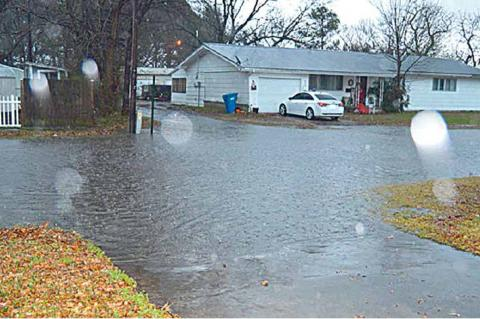 Several streets in Coalgate were closed Friday afternoon and night due to high water. This is S. Byrd St.