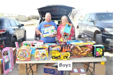 PICTURED AT THE BOYS' GIFT TABLE ARE EVERETT PICKENS AND SHARON PICKENS.