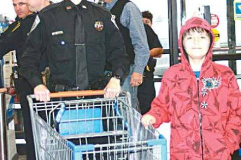 Coal County Sheriff's Deputy Kolton Parker and partner Landom Street get ready to do some fun shopping at Walmart during the Shop with a Cop Christmas shopping spree.